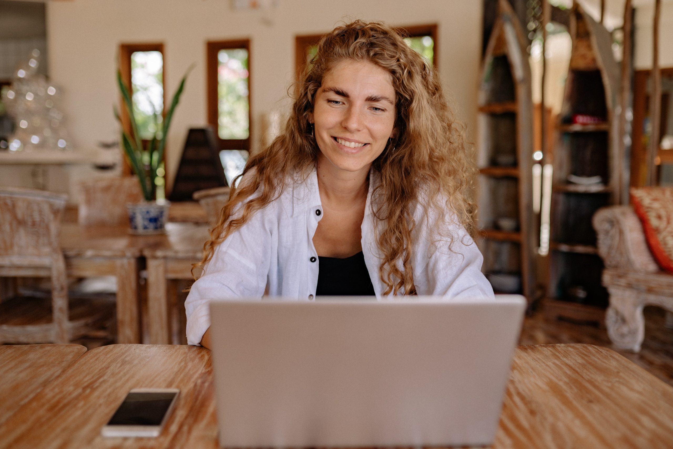 photo-of-woman-smiling-while-using-laptop